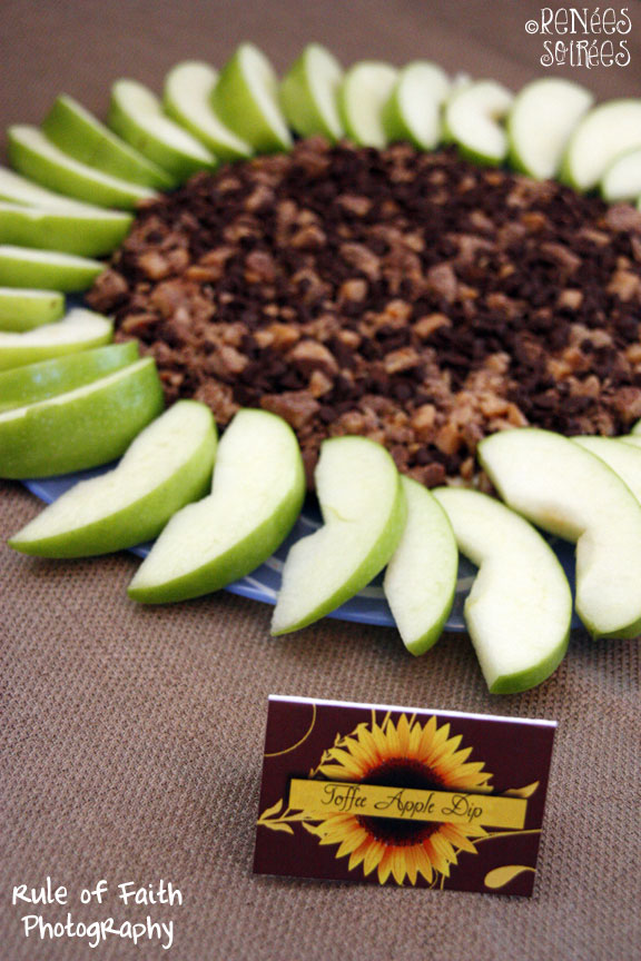apples and dip in the shape of a sunflower with a food label