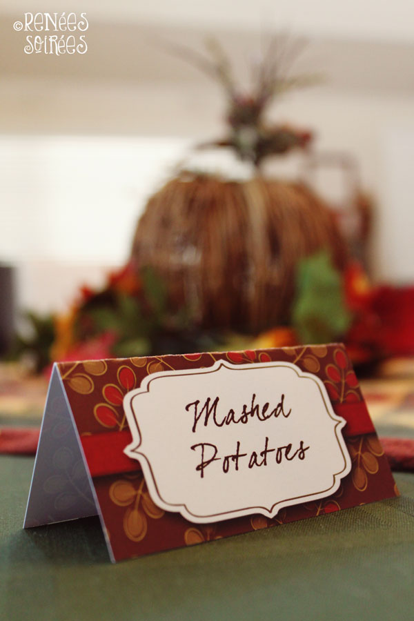 Food tent labeled Mashed Potatoes on a Fall table