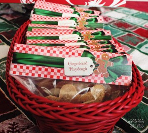 A red basket full of baggies with gingerbread playdough inside
