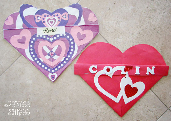 2 paper hearts used as pockets for valentines day at school