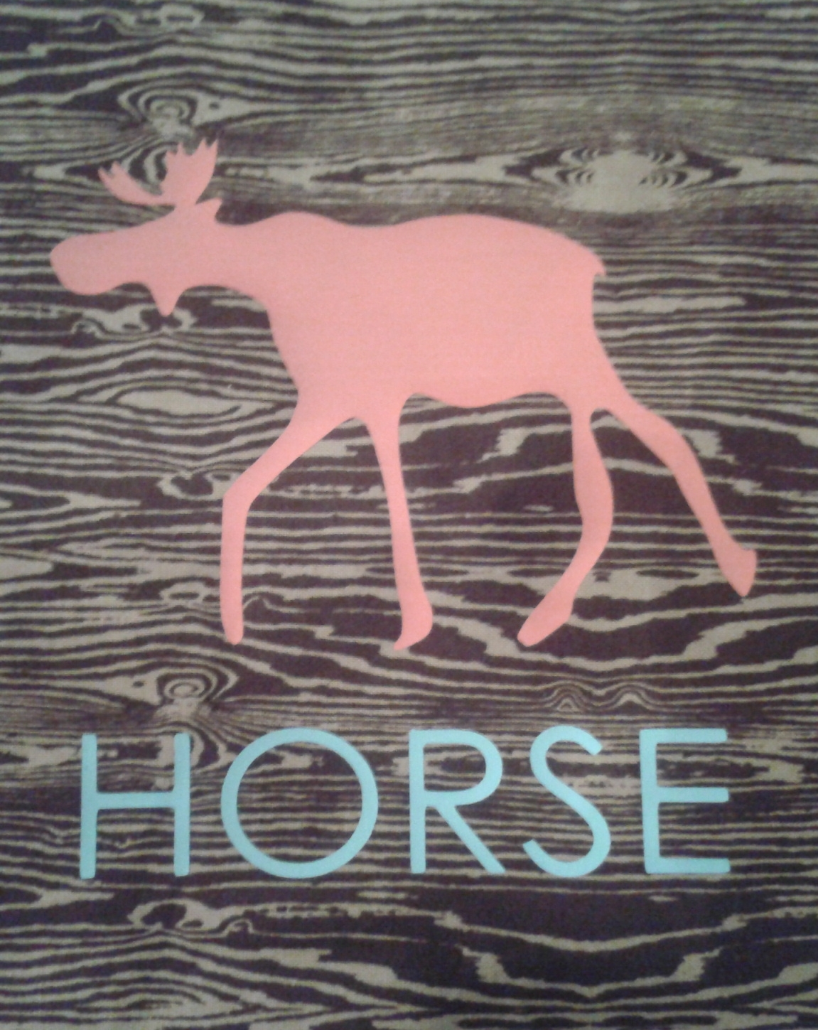 "A quilt square with a drawing of a moose, labeled ""horse"""