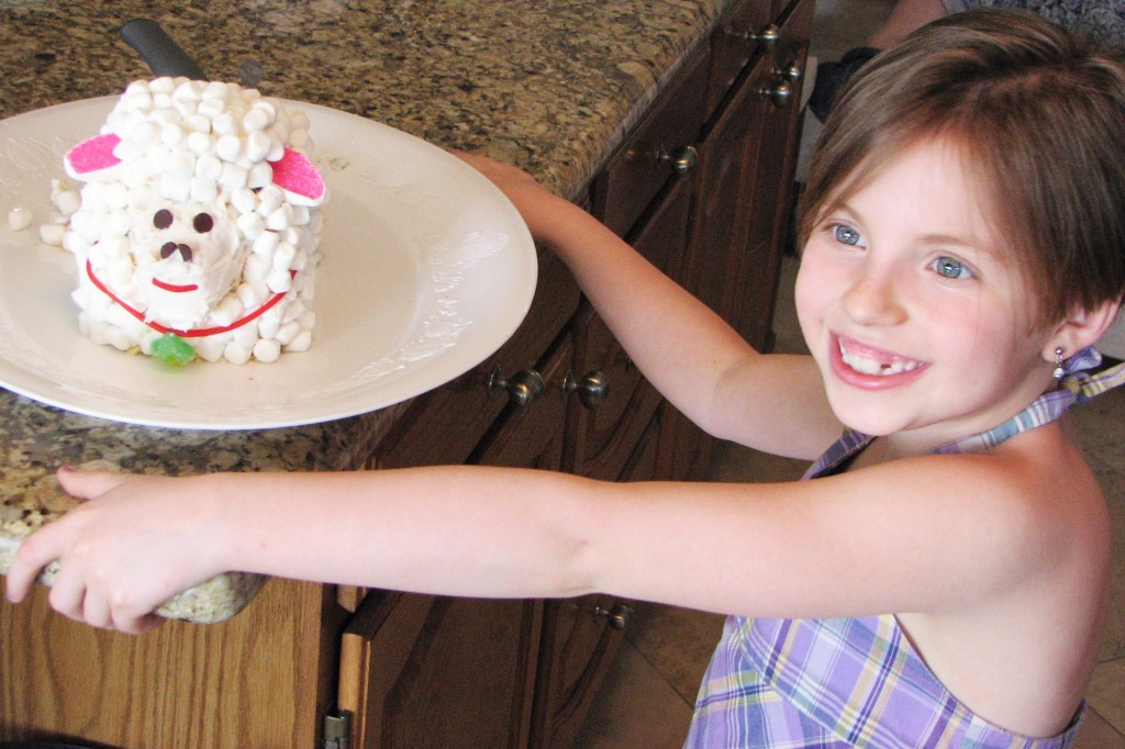 child with Easter lamb cake