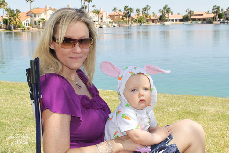 woman holding a baby in a bunny outfit