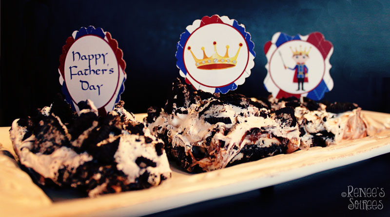 Fathers Day cupcake toppers stuck in a slice of Oreo Cake