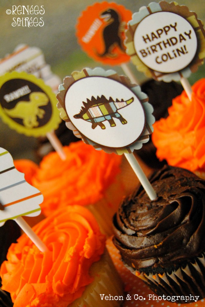 Orange and brown cupcakes with dinosaur toppers