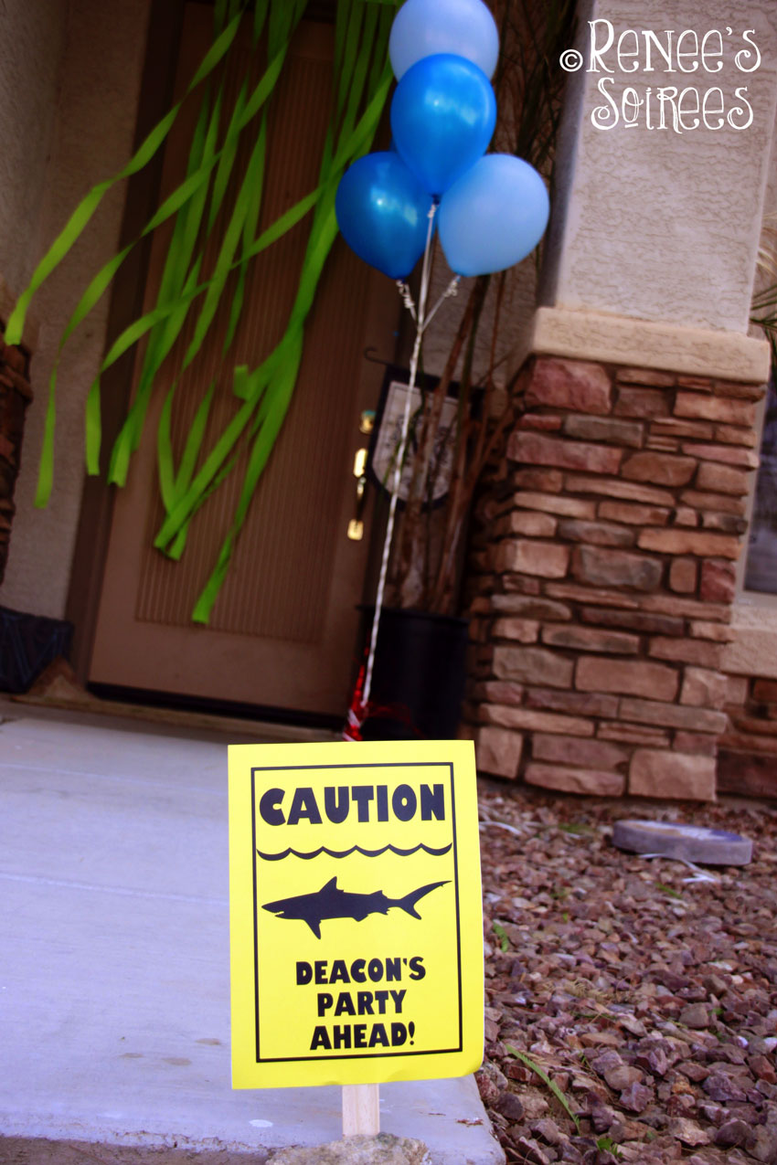 shark-front-door-sign